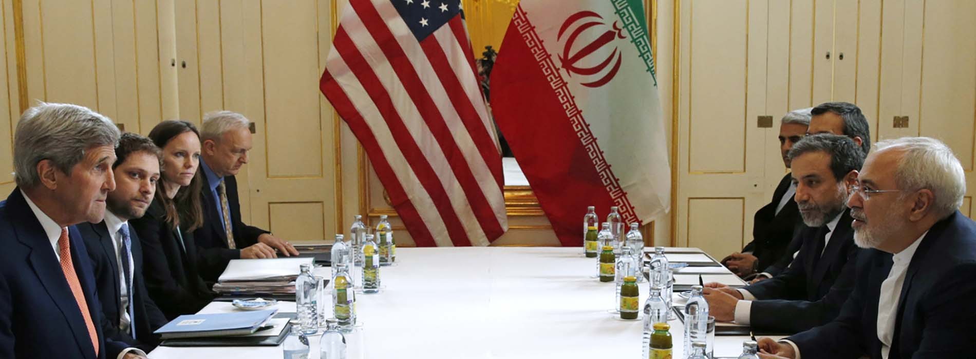 U.S. Secretary of State John Kerry (left) meets with Iranian Foreign Minister Mohammad Javad Zarif (right) in Vienna on Saturday. The International Atomic Energy Agency, or IAEA, has verified that Iran has met all conditions under the nuclea